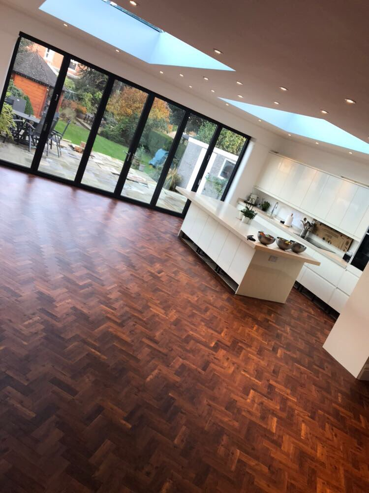 Amtico Signature parquet in Priory Oak laid in a herringbone pattern to a new kitchen extension by Flooring 4 You Ltd