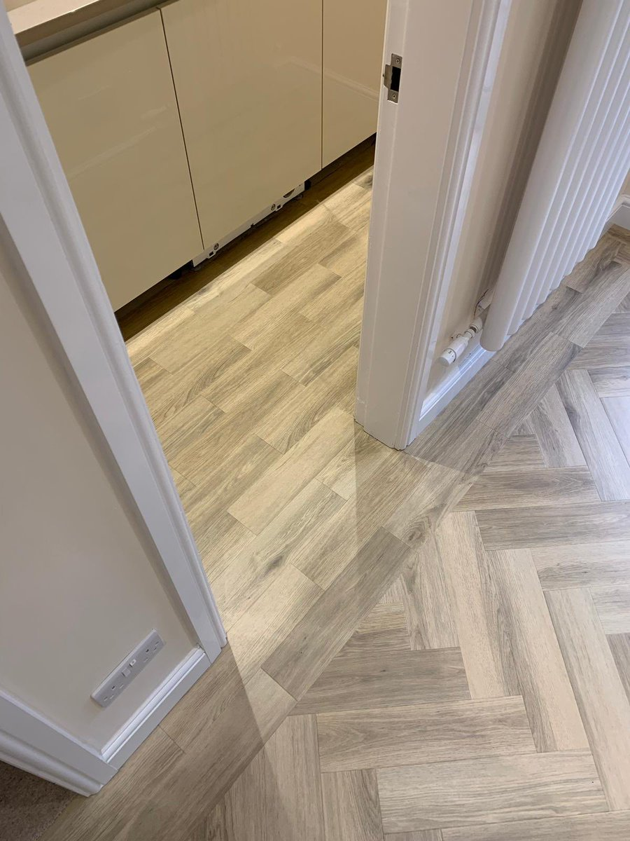 Flooring 4 You Ltd installed Amtico Signatue Cornish Oak in two patterns from room to room