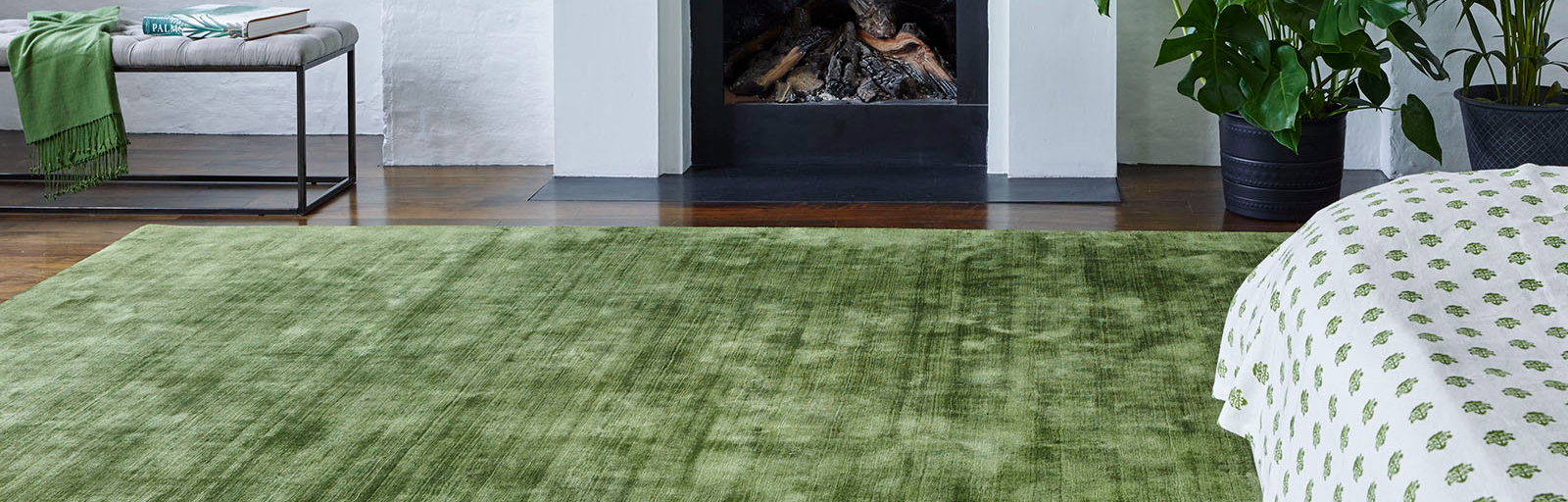 A luxurious Satara rug in moss green,fr om Jacaranda Carpets and available from Flooring 4 You Ltd
