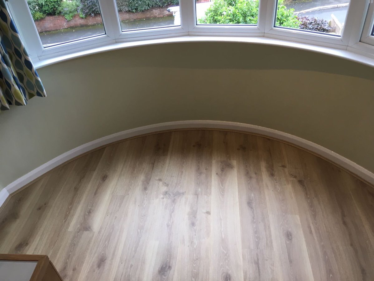 what are the best flooring solutions for landlords showing quick step creo laminate flooring we fitted around a bay window at a home in bowdon the creo range from quick step is a basic laminate plank that