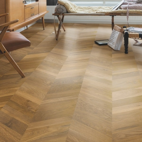 Quick-Step Intenso Traditional Oak Oiled hardwood flooring in a chevron laying pattern available from Flooring 4 You Ltd